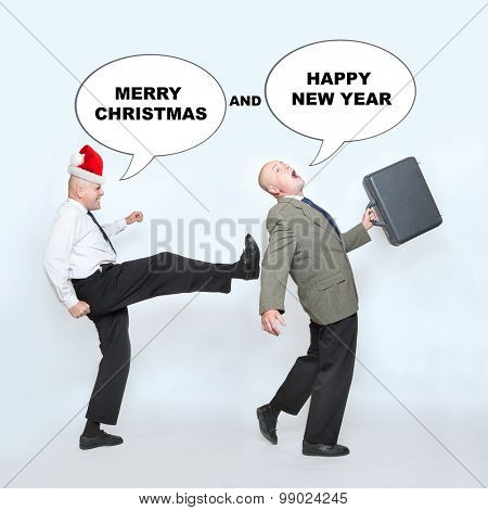 Fired businessman and angry boss on end of the year. Downsizing before christmas. Funny picture from office. Picture with speech bubbles for your text.