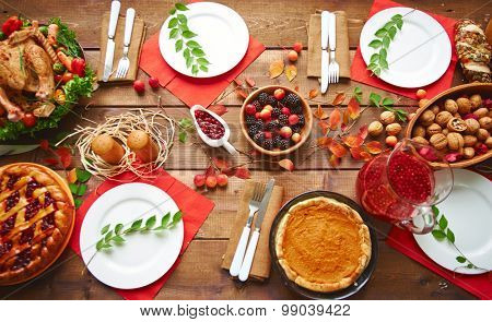 High angle view of table served for thanksgiving dinner with family poster