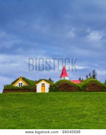 Houses are roofed by the turf and grass. Village of ancestors. The recreated village -  museum of first settlers in Iceland