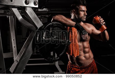The Very Muscular Sporty Guy Drinking Protein In Dark Weight Room, Naked Torso