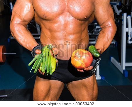 Bodybuilder Holding Vegetables
