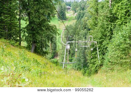 Inoperative Rusty Ski Lift In Woodland On Summer