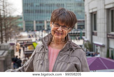 Pension age good looking woman portrait in the City. London