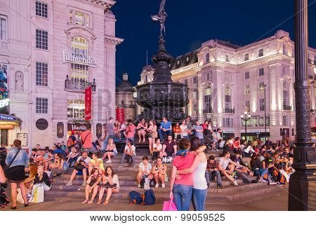 LONDON, UK - AUGUST 22, 2015: Piccadilly Circus in night. Famous place for romantic dates. Square wa