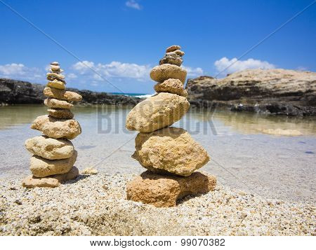 Piramide Stack Of Zen Stones Near Sea And Blue Sky