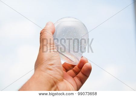 Hand With Snowglobe