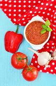 Gazpacho spanish vegetable soup with mint leaf on the red napkin and blue wood table poster