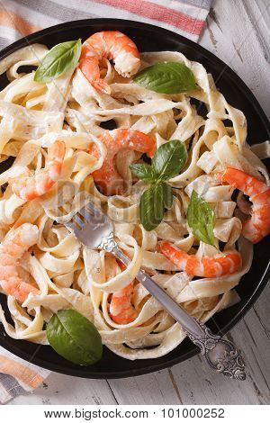 Fettuccini Pasta In Cream Sauce With Shrimp Close-up. Vertical Top View