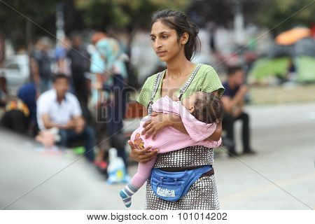 Syrian Refugee Woman With Child In Belgrade