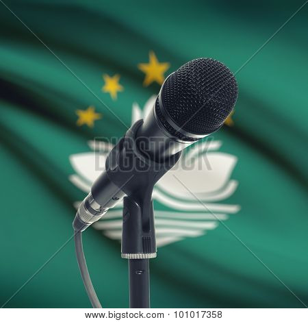 Microphone On Stand With National Flag On Background - Macau