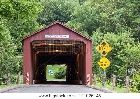 WEST CORNVALL, CONNECTICUT - JULY 15, 2015: The 1864 West Cornwall Covered Bridge. also known as Hart Bridge, is a wooden bridge over the Housatonic River on July 15, 2015 in West Cornwall, CT.