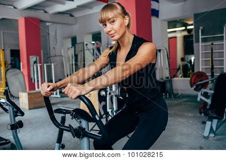 blonde woman on exersizing bike