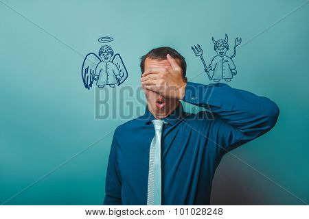 man Male businessman closed his eyes, his hands angel devil demo