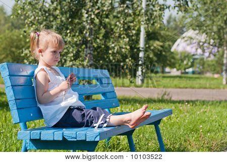 Dreamy Girl On A Park Bench