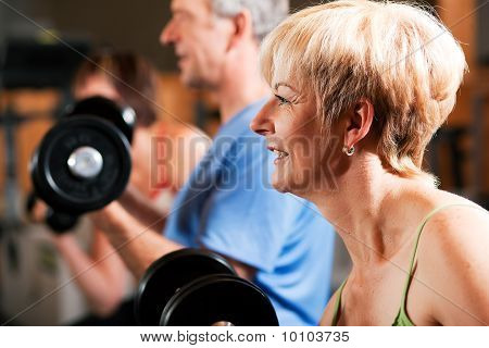 Three senior people in gym