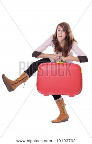 Young Woman With Red Suitcase Making Funny Faces