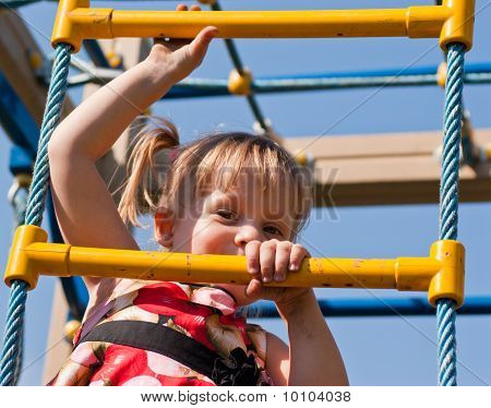 Girl Climbs On The Ladder Of Child