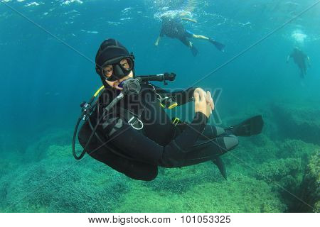 Scuba diver diving instructor underwater