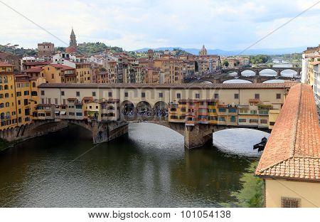 ancient bridge called Ponte Vecchio and Vasari Corridor in Florence Italy from Uffizi Museum poster