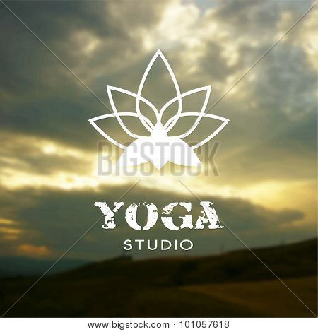 Poster for yoga class with a sunset backdrop.