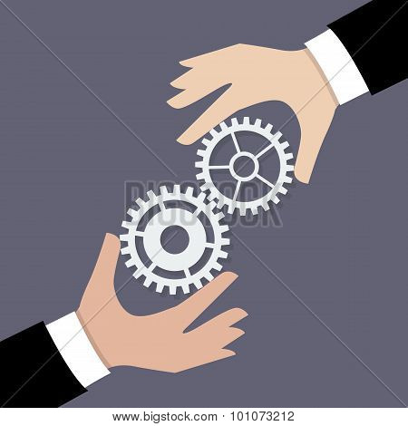 Two Businessman Hands With Gears