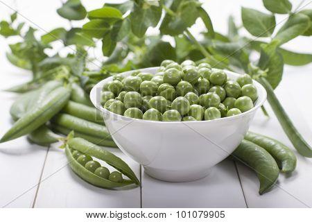Fresh Green Peas In A White Bowl