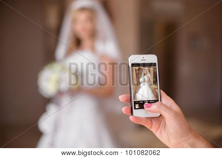 Taking Photo Of Beautiful Bride On Mobile Smart Phone. Wedding Day.