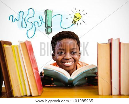 Cute boy reading book in library against white background with vignette