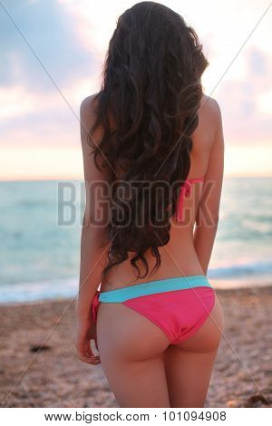 Beautiful Slim Body Girl Model Enjoying Sunset, Wearing In Fashion Bikini Resting On The Beach. Summ