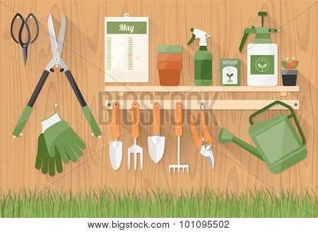 Gardening Tools On A Wooden Shelf