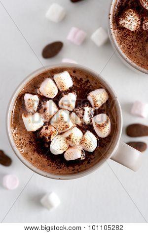 Cup of hot chocolate cocoa drink with toasted marshmallows, overhead milky choc dessert beverage