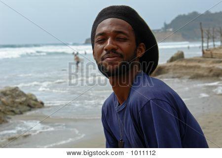 Happy Rasta-Man On The Beach Of Pacific Ocean