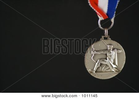 Medal With Archer And Black Background