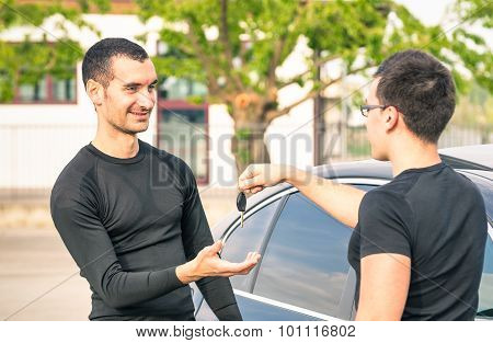 Happy Satisfied Young Man Receiving Car Keys After Second Hand Sale - Concept Business Transport
