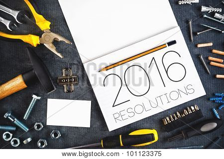 2016 New Year Resolutions Craftsman Workshop Concept with Asorted Tools Pencil and Notebook for Writing Goals and Aspiration in Following Year poster