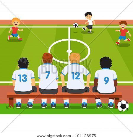Children soccer team sitting on a bench