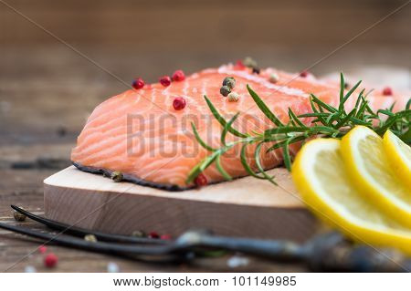 Raw Salmon Fish Fillet With Lemon And Fresh Herbs