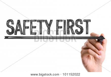 Hand with marker writing the word Safety First