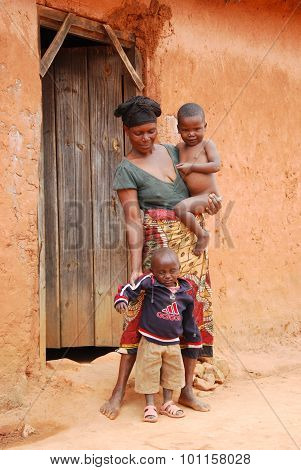 An Unidentified African Woman With Her Children On The Doorstep 42