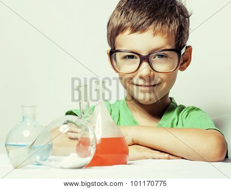 little cute boy with medicine glass isolated wearing glasses smiling