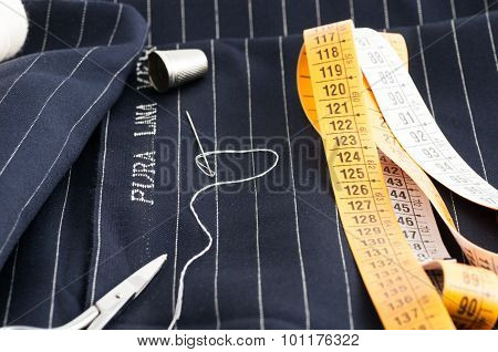 view of a tailored suit from a tailor in his studio poster