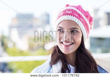 Beautiful woman wearing woolly hat outside