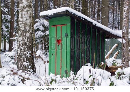 Rural old outhouse in winter