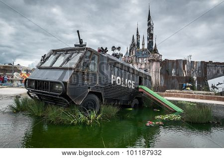 A Police Riot Van In Water Cannon Creek At Banksy's Dismaland Bemusement Park