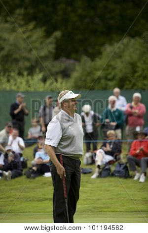 WENTWORTH, ENGLAND. 22 MAY 2009.Colin MONTGOMERIE SCO  smiling after sinking a putt playing in the 2nd round of the European Tour BMW PGA Championship.