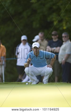 WENTWORTH, ENGLAND. 24 MAY 2009.Paul Casey lines up a putt on his way to winning the European Tour BMW PGA Championship.