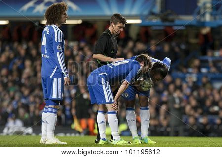 LONDON, ENGLAND. 06 DECEMBER 2011.  Chelsea's midfielder Juan Mata and forward Didier Drogba discuss a free kick during the UEFA Champions League match between Chelsea and Valencia from Spain,