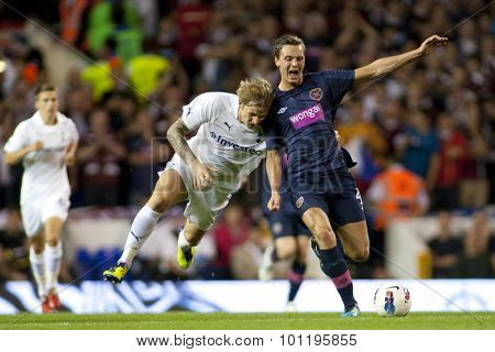 LONDON ENGLAND 25 August 2011. Tottenham's Roman Pavlyuchenko appears to rugby tackle Hearts player Eggert J�¢hnsson during the UEFA Europa league match between Tottenham Hotspurs  and Hearts.