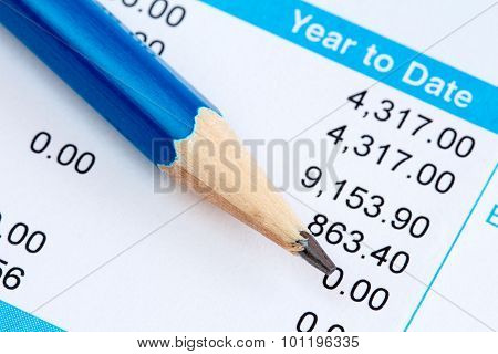 Pencil And Wage Slip