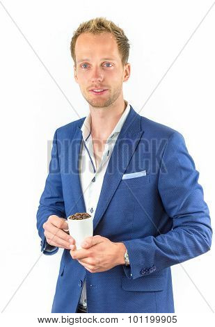 Young Salesman Promoting Coffee Beans In Cup